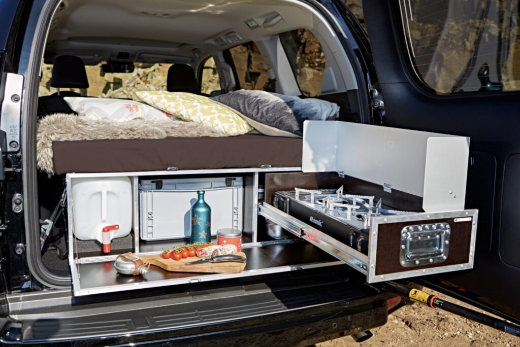 SUV camper conversion kit - Kitchen extended in back of car