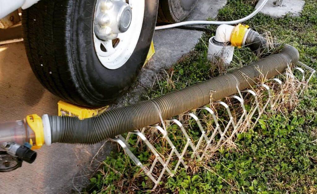 RV sewer hose on raised holders