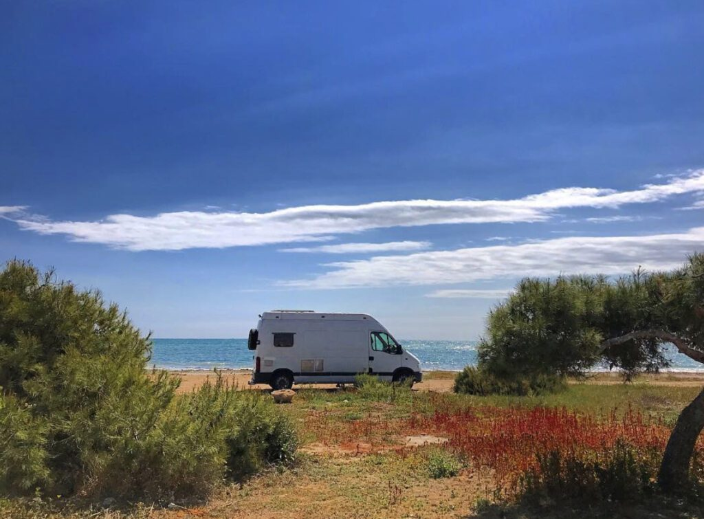 Living n a camper - can on the beach with ocean in background