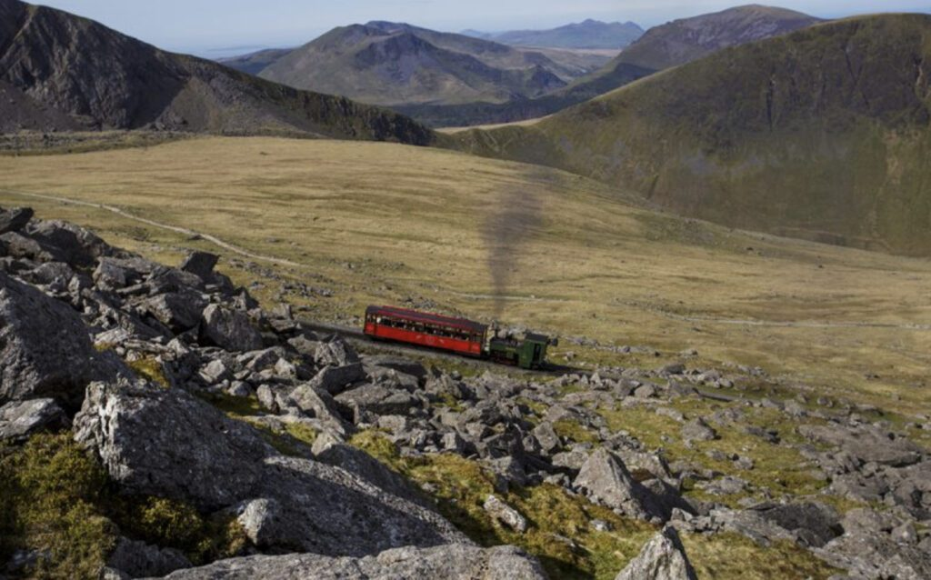 Places to visit in UK  - train going up Mount Snowdon