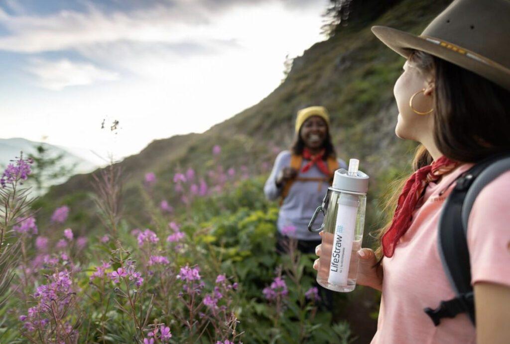 Two women drinking water