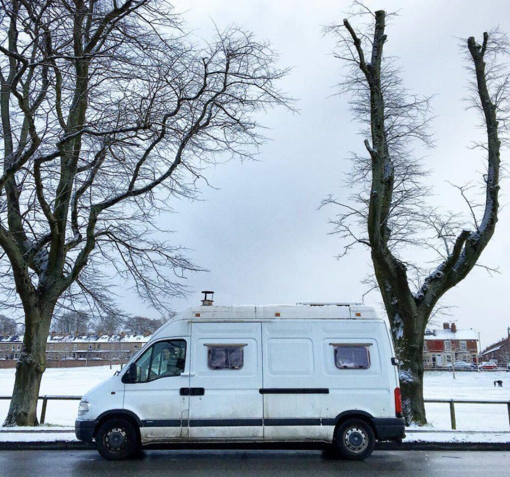 Van on a road in the snow