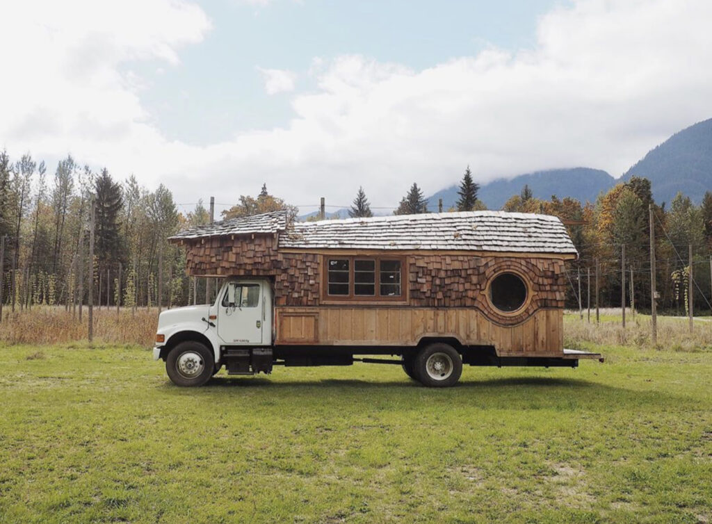 Conversion Vans - Handbuilt truck camper with wooden shingles making exterior walls