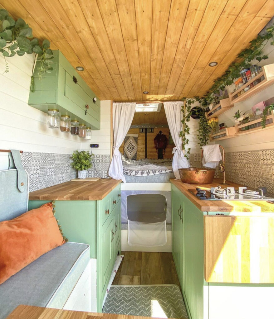 Conversion Vans - van interior with fixed bed, kitchen and seating