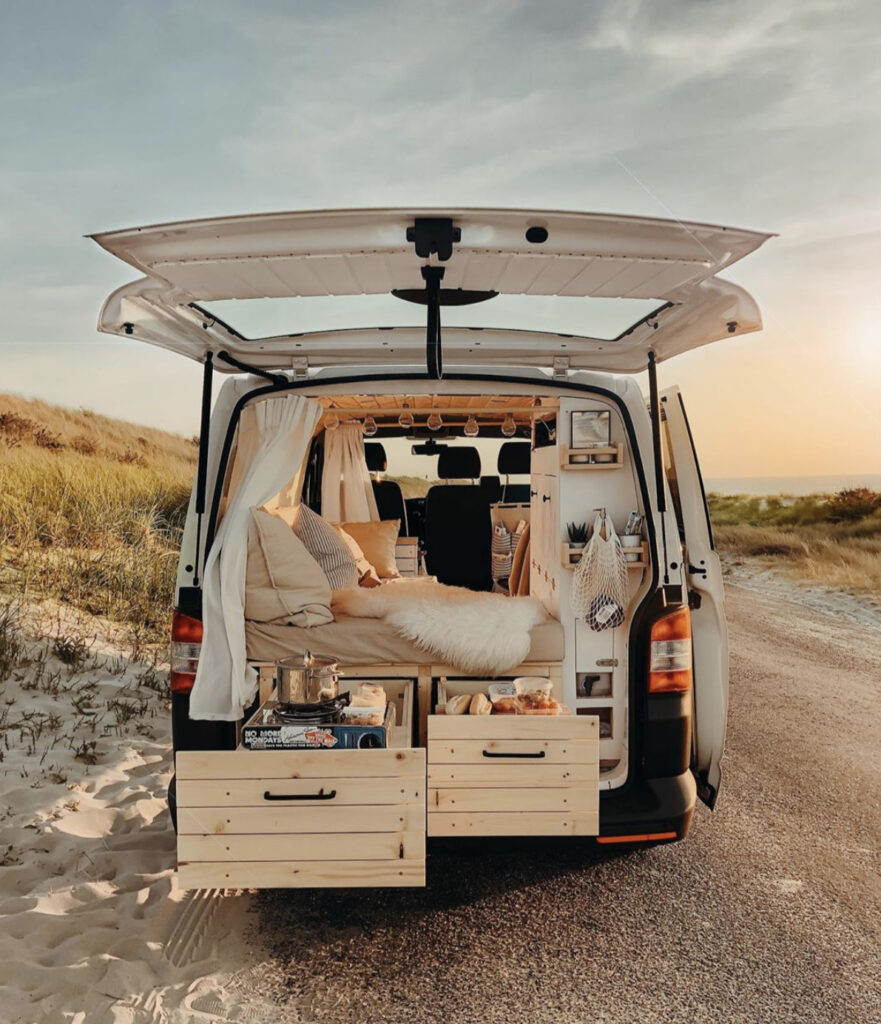 Smaller van parking by the beach, slide out kitchen at back