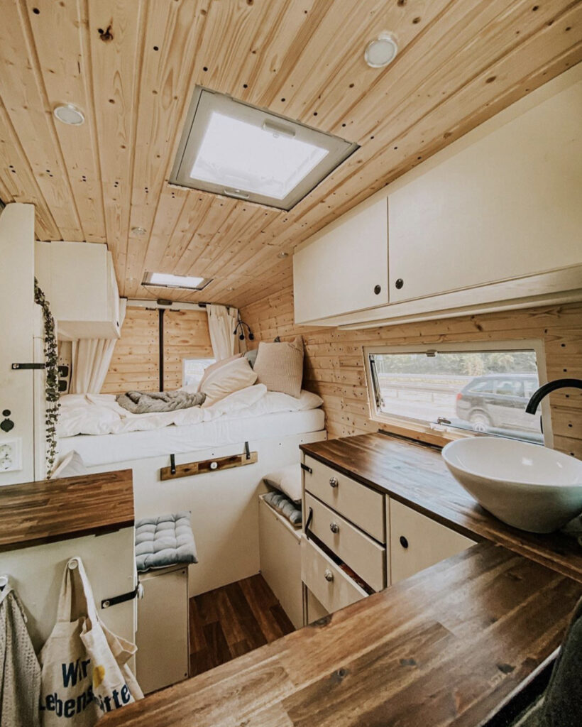 Conversion Vans - Sprinter conversion with wooden walls, fixed bed at back, seating infront and kitchen