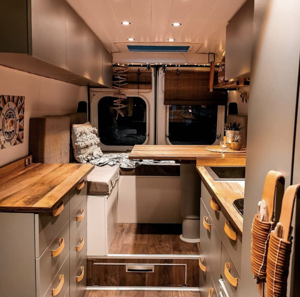 Conversion Vans - Seating area that converts to bed at back, kitchen at front in dark grey