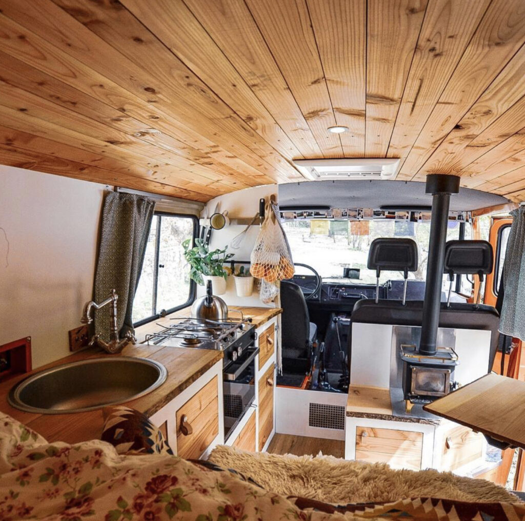 Larger van with fixed bed, seat, kitchen and wood burner