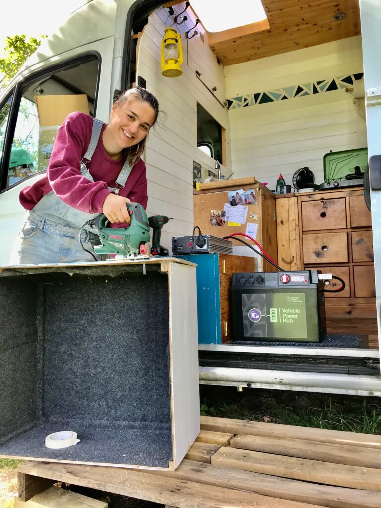 Campervan electrics - Rose using the Vehicle Power Hub outside our van