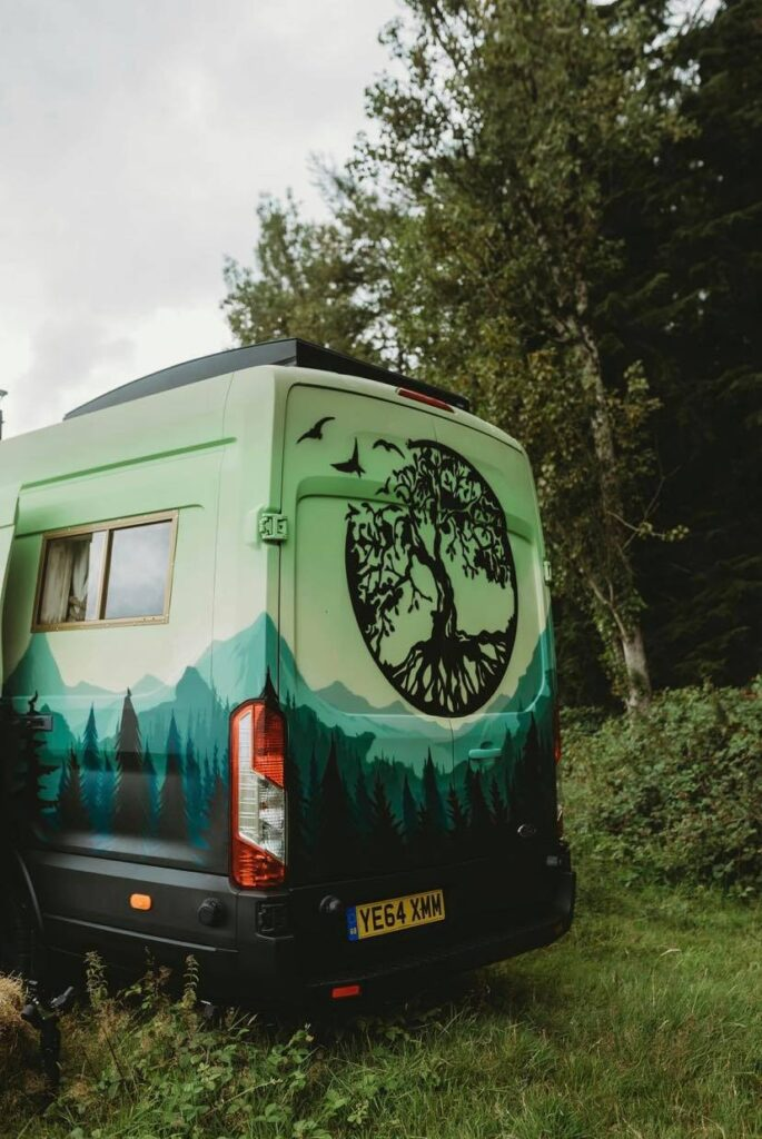 Handcrafted Rustic Campervan with a tree logo on the back, custom