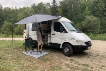exterior of the van, set up with an awning