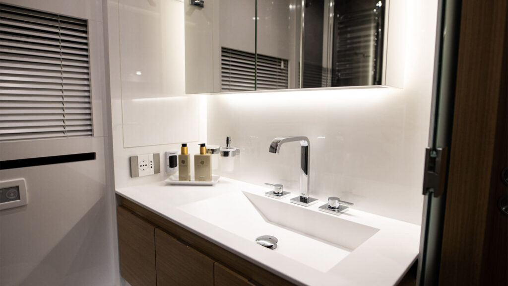 The white sink and back light mirror