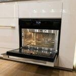 Microwave oven hidden in kitchen.