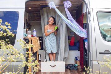 Indoor Drawer Style Shower In van being used